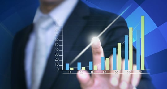 Image of a hand tracing a bar graph showing improvement, representing successful case studies with DevOps