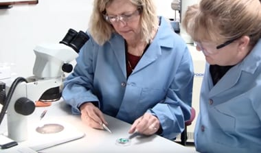 Photo of women in lab coats in a science lab