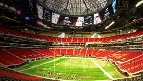 Football stadium with red seats