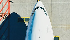 Overhead photo of the nose of an airplane parked on a runway