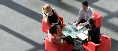 4 people sitting around a small table
