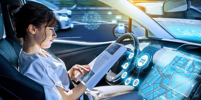 Woman reading while in a self-driving car