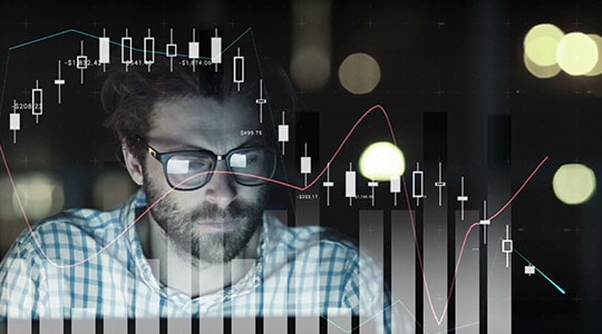 Picture of a man analyzing data