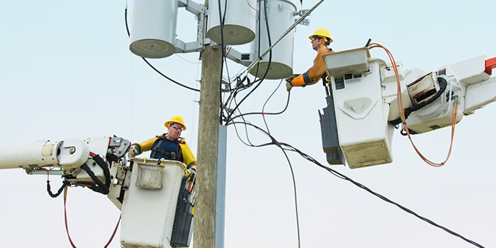 Two men fixing the electric grid
