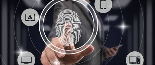 representation of a fingerprint and a man pointing its finger to it