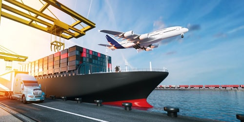 Composite graphic of airplane in flight, loaded cargo ship and truck