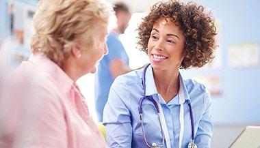 Nurse speaking with elderly patient