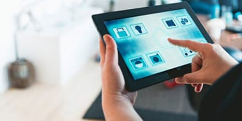 hands using tablet with Smart Home icons