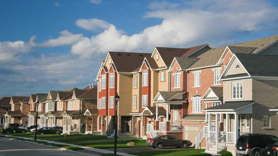 image of a block of houses in a suburban neighborhood