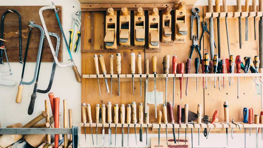 image of tools arranged on a workshop wall