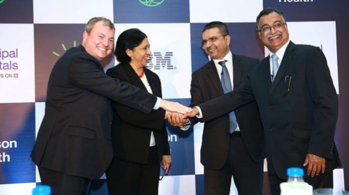 Manipal hospitals executives shaking hands