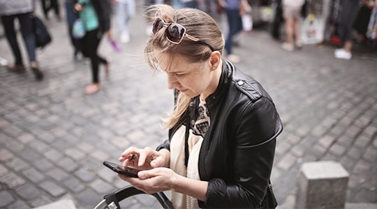 Woman in city using smartphone