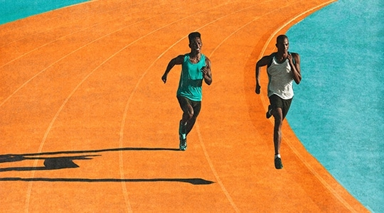 Athletes running on track
