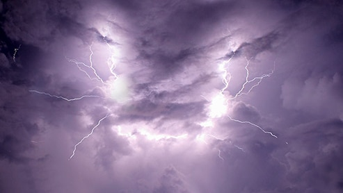 purple sky with lightning flashes and strikes