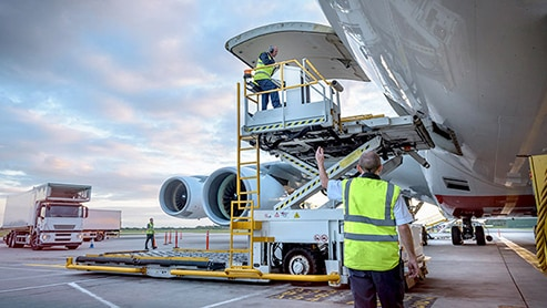 aircraft personnel working on jet airliner