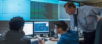 three man working in a security center