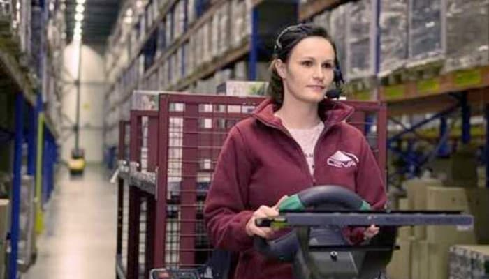 woman driving forklift truck