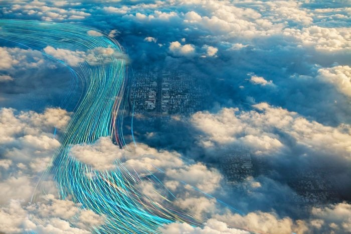 Aerial view through clouds of graphic streams of data moving