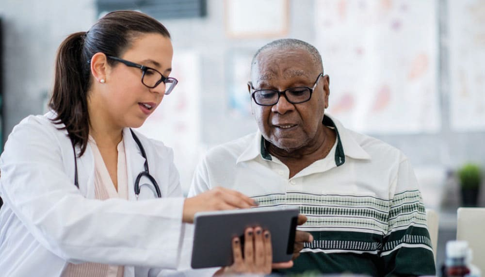 Healthcare professional showing patient their medical chart