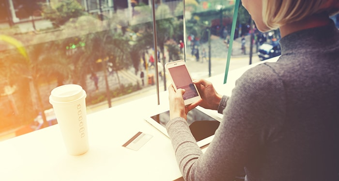 Customer engaging with a brand through alerts on a mobile device