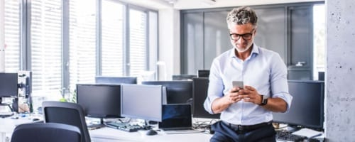 man using a smartphone in the office