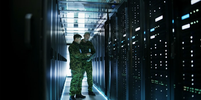 Two army soldiers checking the servers