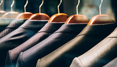 Row of suit jackets on hangers