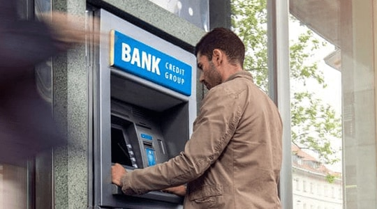 A man at an ATM machine representing the Bendigo and Adelaide Bank case study