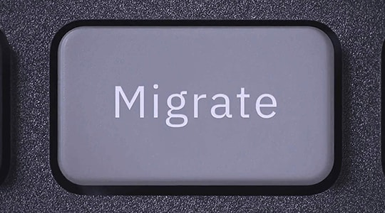 A keyboard button with the word Migrate printed on it