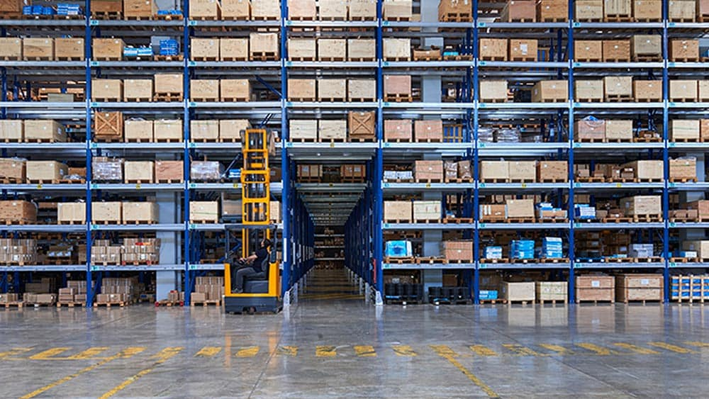 A large warehouse filled with stacks of items indicates the importance of application integration
