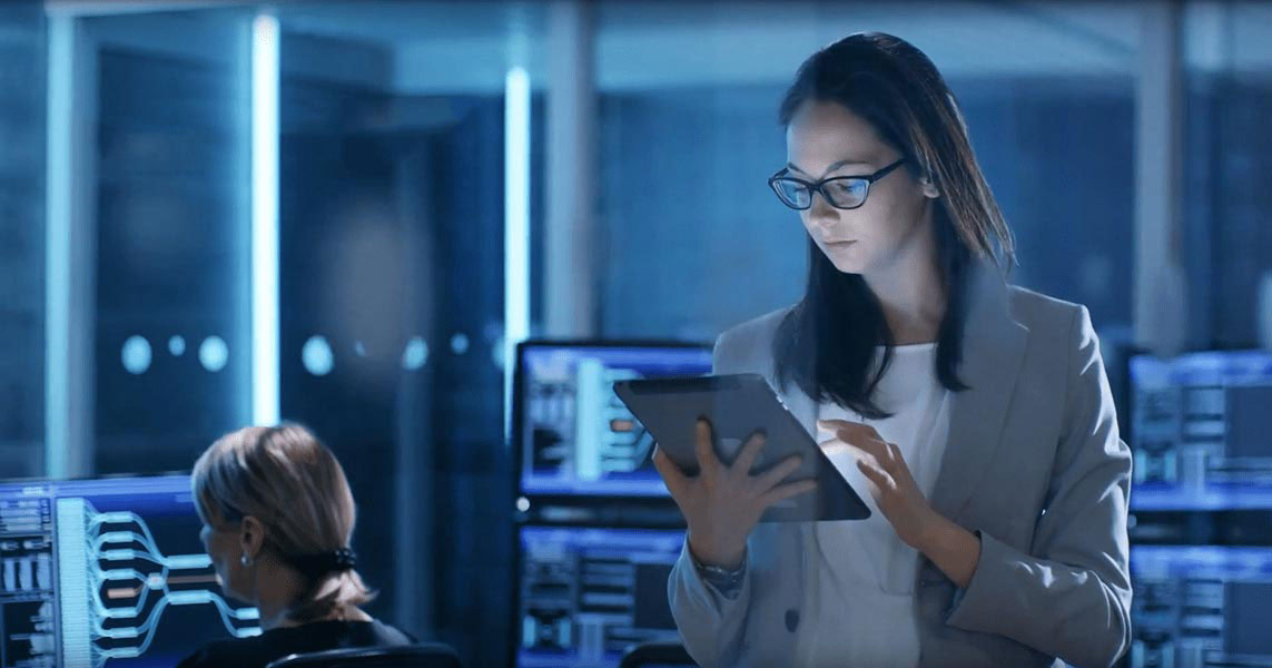 Woman in data center working on tablet