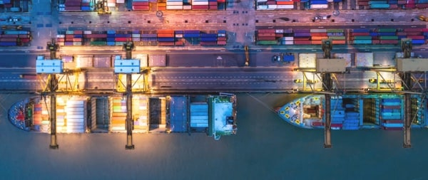 Cargo ships and hundreds of containers viewed from above