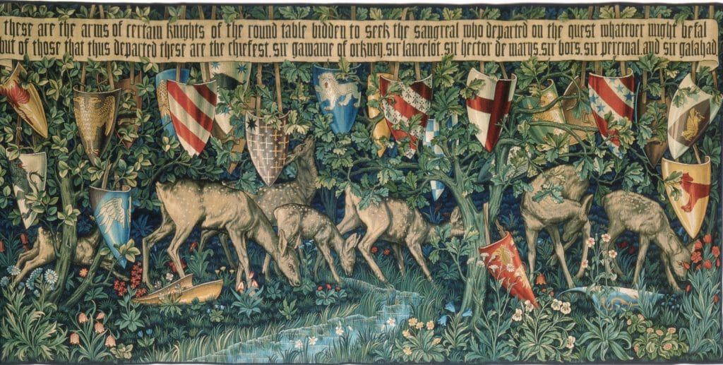 Verdure with Deer and Shields. An accompaniment to the Holy Grail tapestries woven by Morris & Co for Stanmore Hall. This version was woven in 1900, around 700 years after the Arthurian stories were first recorded.