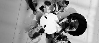 people having a meeting around a table