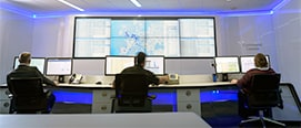 people working at a monitoring room