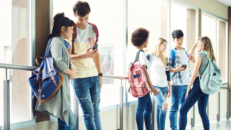 students standing talking at school