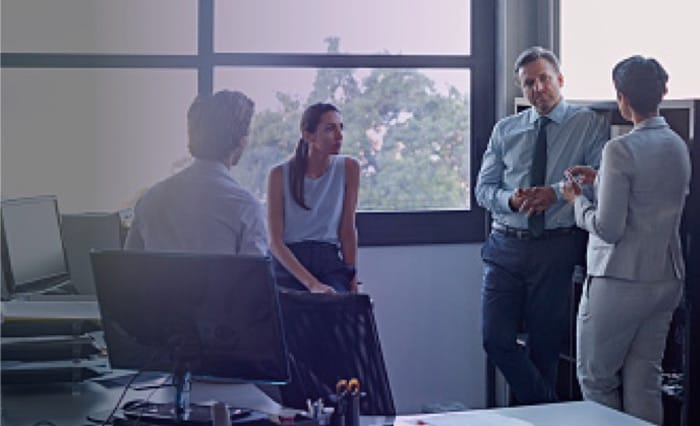 Four people talking at the office