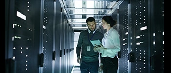 Two professionals in data center