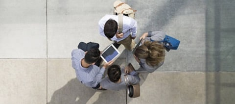 aerial view of 4 people standing up forming a circle
