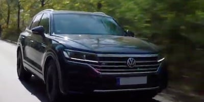 front view of a volkswagen vehicle on a road