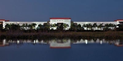 Photo of City Furniture office taken from a distance behind a pond