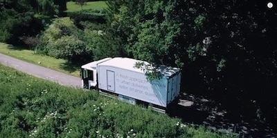 Overhead view of a truck traveling down a small road in the country