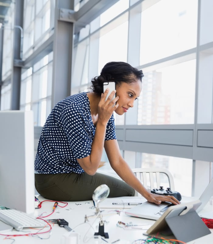 women talking on a phone in a desk