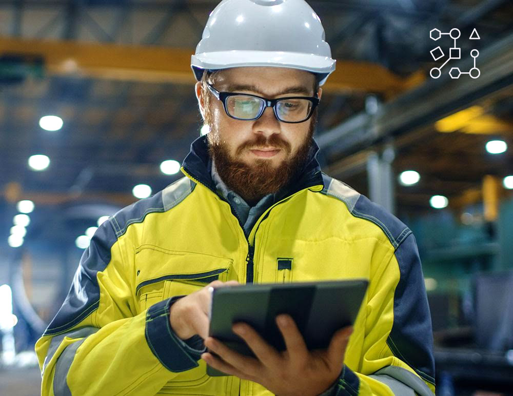 Engineer inside factory using a tablet