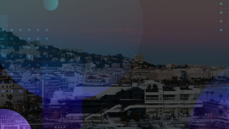 cityscape of Cannes with abstract circles overlaid on top
