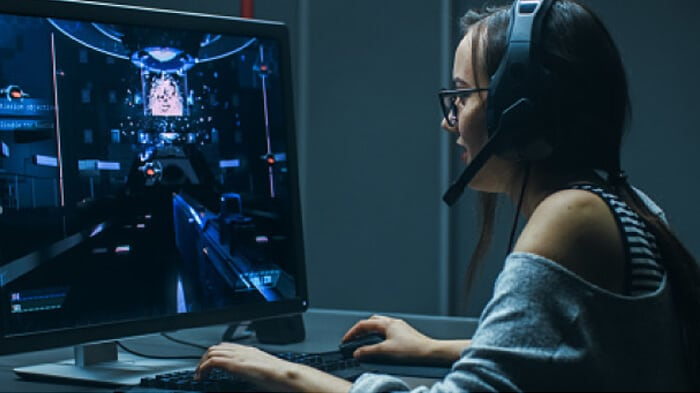 A woman playing a computer game using IBM's dedicated game server hosting.