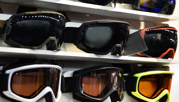 Ski goggles in a variety of colors displayed on a shelf and ready for purchase