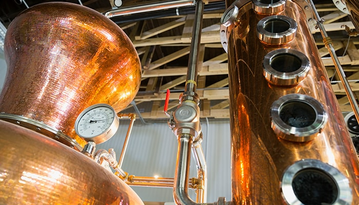 Gauges and piping on copper fermentation tanks at Anheuser-Busch, Labatt Canada