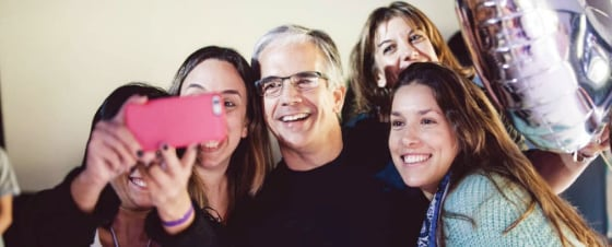 Group of happy people taking selfie