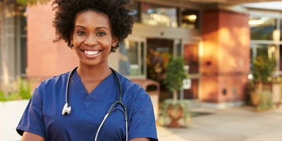 Nurse standing in front of a health clinic
